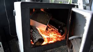 how to burn sawdust in a wood stove youtube