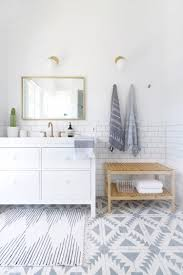 white and grey bathroom design with stunning tile flooring pattern