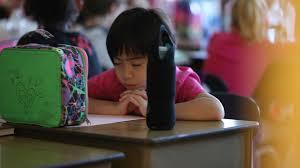 student praying jpg
