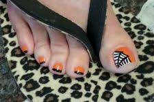 picture of orange toe nails with spiders and polka dots look cut