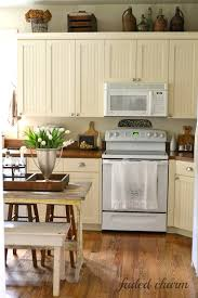 faded charm cream cabinets wood counters i think white