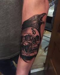 a hollywood undead tattoo the dove and grenade tat on the arm i