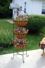 exclusive wrought iron flower pots holder to draw your attention