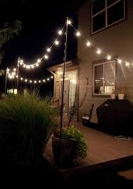 outside party lights ideas outdoor party lights step 8 drape lights from your poles and you