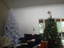 big white fluffy 9 foot christmas tree and 6 7 green fat