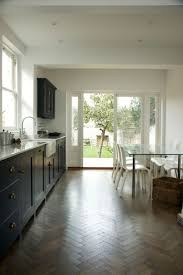 best 25 reclaimed parquet flooring ideas on pinterest white bath shaker kitchen white walls and pantry blue cabinets make this stunning kitchen a bright