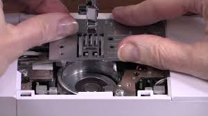 how to clean the bobbin area of a sewing machine youtube