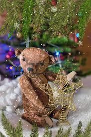 Teddy Bear Christmas Tree Ornaments by An Old Antique Teddy Hugs His New Little Teddy Bear Friend In