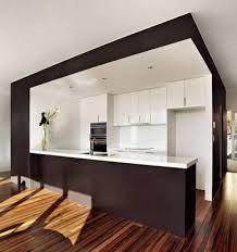 ouverture entre cuisine et salle à manger la cuisine ouverte ose le noir pour se faire déco