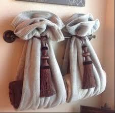 towel folding ideas for bathrooms bathroom towel decorating ideas inspired2ttransform decorating