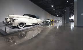 polished concrete positively reflects high end cars concrete decor