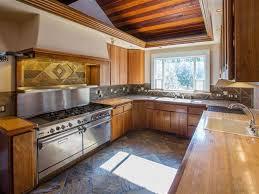 rustic kitchen with custom hood u0026 drop in sink in spokane wa