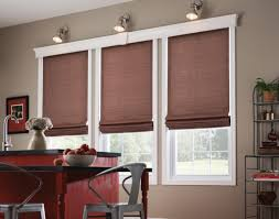 elegant drapes and roman shades enhance home decor