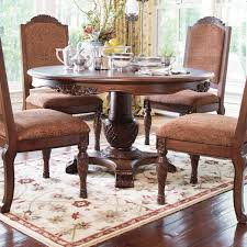 North Shore Round Pedestal Dining Table And  Upholstered Arm - North shore dining room