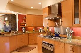 maple cabinets with black island kitchen remodels tucson