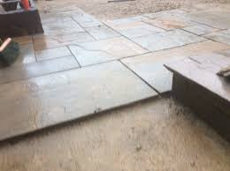 Indian Sandstone Patio by Two Tiered Brown Indian Sandstone Patio U0026 Astro Turf With Feature