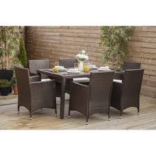 7 piece dining table set with 6 cube chairs in brown rattan cube