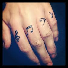 cool small music tattoo on finger as well as small but meaningful