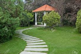 sumerhouse and curving walkway in the garden stock photo picture
