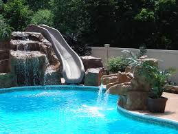 cool pools with waterfalls in houses connect the as a slide and