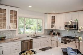 White Carrera Marble Kitchen Countertops - traditional kitchen with dual sinks by vicky smirnoff zillow