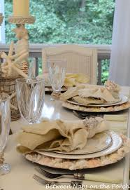 themed tablescapes themed table setting with shell chargers