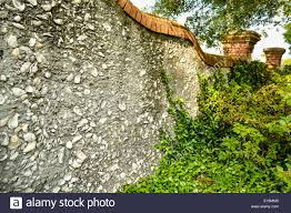 a lovely curved garden wall made from tabby a concrete like