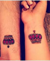 pink matching crown tattoo on wrists