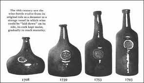 unique shaped wine bottles on wine