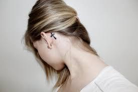 black cross tattoo on behind the ear by soikkuu