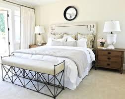 bedroom with wooden nightstands and bench featured metal legs