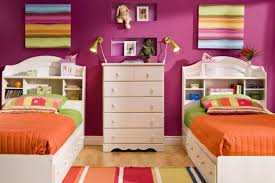 kids bedroom with pink walls and white twin bed frames buying