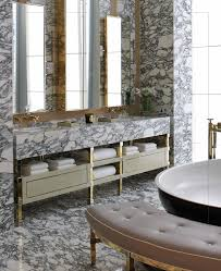 Double Vanity Mirrors For Bathroom by Heavily Figured Marble Gold Accents A Triptych In Mirrors Above