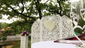 arch decor of flowers on a wedding ceremony in the park stock