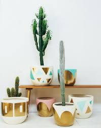 assorted pop and scott hand painted pots with patterns in gold