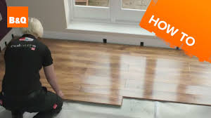 Laminate Flooring B Q How To Lay Flooring Part 3 Laying Locking Laminate Youtube