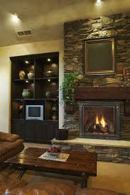 fieldstone is used to build a rugged fireplace surround in a
