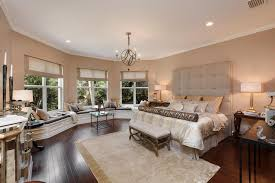 High Window Seat - contemporary master bedroom with window seat by luxury home