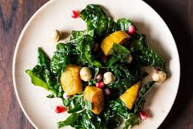 hearty kale salad with kabocha squash pomegranate seeds and