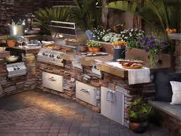 beautiful tuscan style rustic summer kitchen with stone cabinets