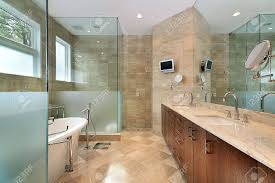 modern master bath in luxury home with glass shower stock photo