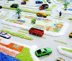 3d play carpets bring miniature lands of make believe to the