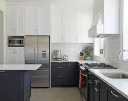 Black And White Kitchen With White Top Cabinets And Black Bottom - White kitchen cabinets with white backsplash