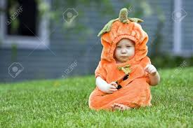pumpkin costume halloween cute boy in a halloween pumpkin costume stock photo picture and