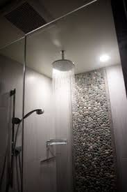 amazing bathroom features a walk in shower accented with a gray