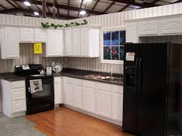 pictures of small kitchen designs appliances black range stove with white kitchen cabinet also