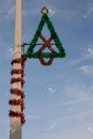 christmas decoration on a street light post stock photo picture