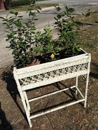 vintage wicker plant stand and galvanized tin planter old white