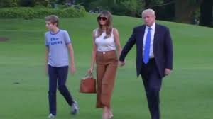 melania trump wears tight skinny jeans with donald and barron on