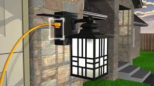 Bathroom Lights With Outlets Sunbeam Led Wall Lantern With Gfci And Sensor Outdoor Lights